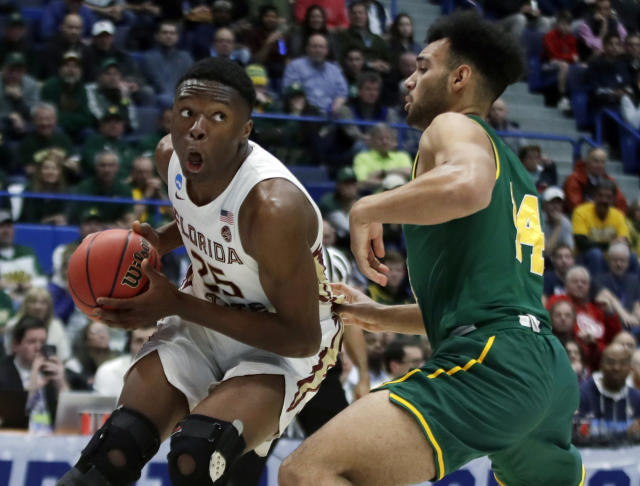 Florida State's Mfiondu Kabengele (25) looks for room to drive against Vermont's Isaiah Moll (14) during the first half of a first round men's college basketball game in the NCAA Tournament, Thursday, March 21, 2019, in Hartford, Conn. (AP Photo/Elise Amendola)