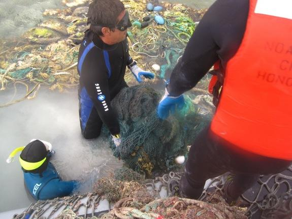 Divers remove nets and debris from the Pacific during a June/July 2012 NOAA mission.