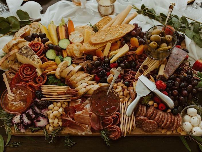 An elaborate cheese board sits on a table.