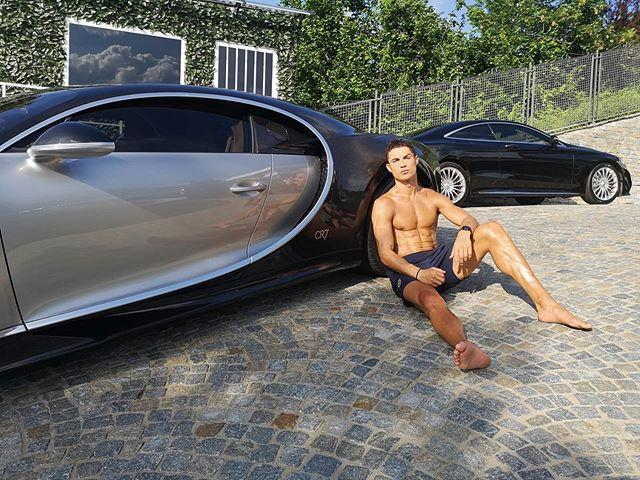"""<p>Ronaldo poses shirtless in front of his Bugatti Chiron in this July 2020 snap. When mortal abs can compete with a $3 million car, that's when you know the thirst trap is doing its job.</p><p><a href=""""https://www.instagram.com/p/CDUDM7XgxH3/"""" rel=""""nofollow noopener"""" target=""""_blank"""" data-ylk=""""slk:See the original post on Instagram"""" class=""""link rapid-noclick-resp"""">See the original post on Instagram</a></p>"""