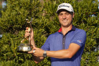 Justin Thomas holds the trophy after winning The Players Championship golf tournament Sunday, March 14, 2021, in Ponte Vedra Beach, Fla. (AP Photo/John Raoux)