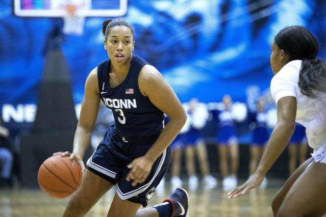 Connecticut forward Megan Walker (3) drives defended by Memphis guard Jamirah Shutes, right, in the first half of an NCAA college basketball game Tuesday, Jan. 14, 2020, in Memphis, Tenn. (AP Photo/Nikki Boertman)