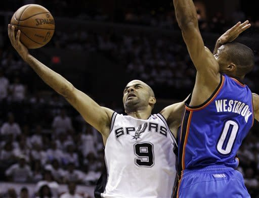 San Antonio Spurs point guard Tony Parker (9), of France, shoots against Oklahoma City Thunder point guard Russell Westbrook during the first half of Game 5 in the NBA basketball Western Conference finals, Monday, June 4, 2012, in San Antonio. (AP Photo/Eric Gay)