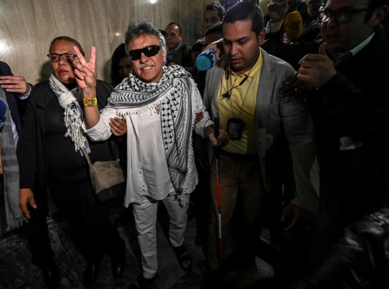 Former FARC guerrilla leader Jesus Santrich (C), was sworn in as a Colombian senator June 11, 2019 but has since disappeared after failing to appear in court to face a US extradition request over drug trafficking charges (AFP Photo/Juan BARRETO)