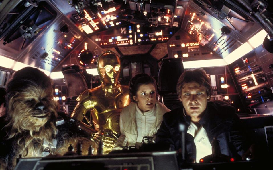 Carrie Fisher (second right) and Harrison Ford (first right) fly to Cloud City, in a scene from Star Wars: The Empire Strikes Back (1980) - Film Stills