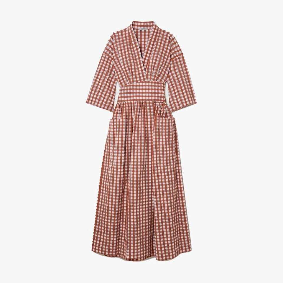 "$785, NET-A-PORTER. <a href=""https://www.net-a-porter.com/en-us/shop/product/three-graces-london/clothing/midi-dresses/charita-gingham-cotton-blend-seersucker-wrap-midi-dress/6630340699402209"" rel=""nofollow noopener"" target=""_blank"" data-ylk=""slk:Get it now!"" class=""link rapid-noclick-resp"">Get it now!</a>"