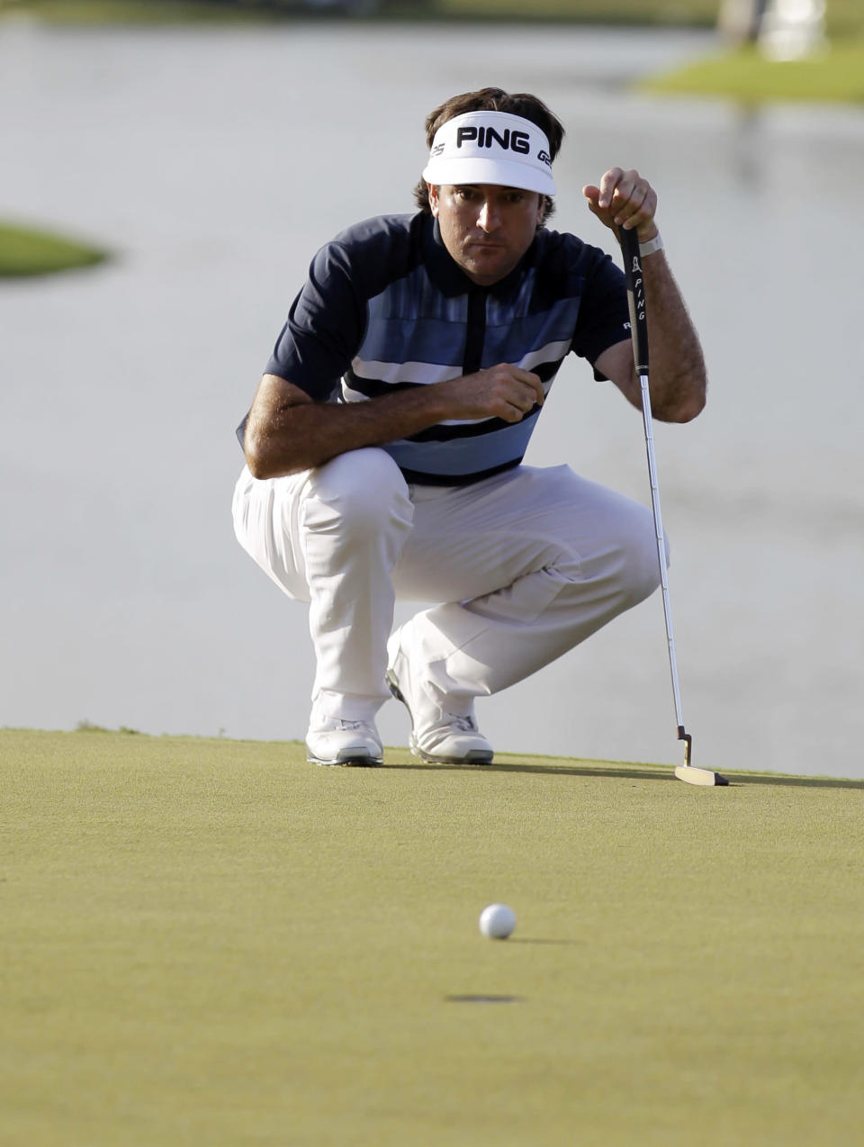 Bubba Watson looks at his shot on the 18th green during the final round of the Cadillac Championship golf tournament Sunday, March 9, 2014, in Doral, Fla. (AP Photo/Luis Alvarez)