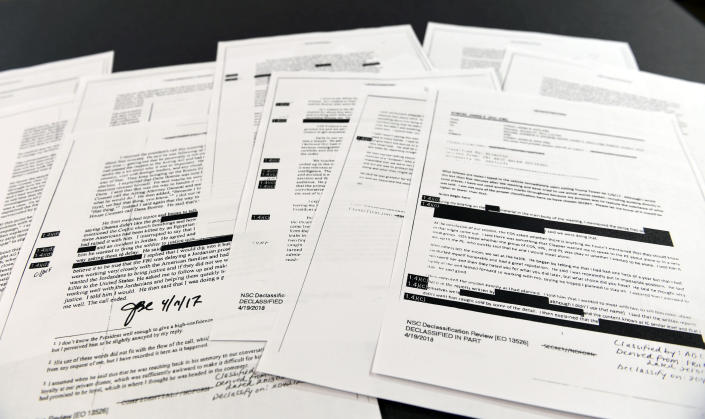 Copies of redacted versions of the memos of former FBI Director James Comey are pictured in Washington on April 19, 2018. (Photo: Susan Walsh/AP)