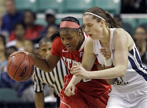 North Carolina State's Bonae Holston, left, and Georgia Tech's Tjasa Gortnar, right, collide during the first half of an NCAA Atlantic Coast Conference women's tournament basketball game in Greensboro, N.C., Saturday, March 3, 2012. (AP Photo/Chuck Burton)