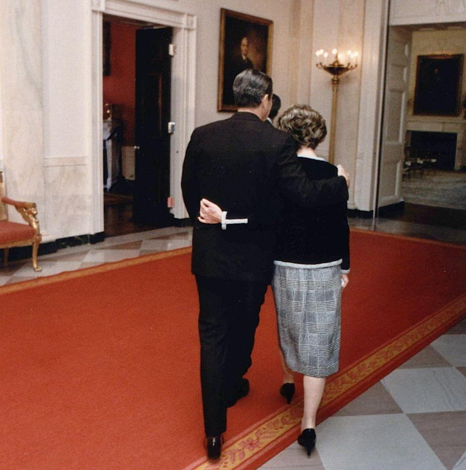 <p>The couple was photographed walking towards the White House State Dining Room with their arms around each other. </p>