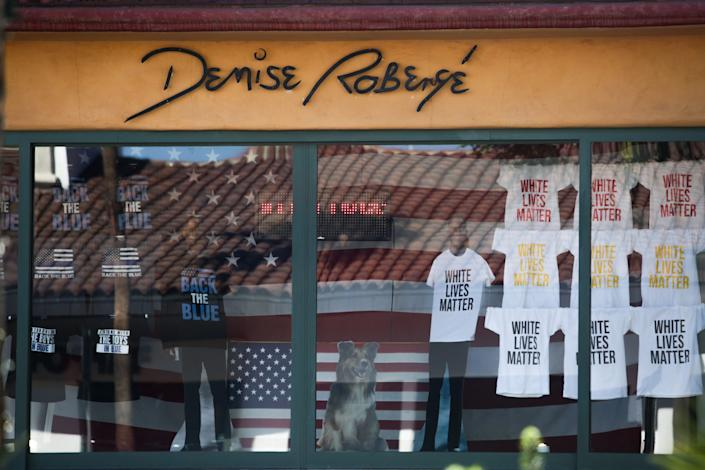 "A window display shows shirts reading ""white lives matter"" and ""back the blue"" at Denise Robergé Jewelry and Art Gallery on El Paseo Drive in Palm Desert, Calif. on Monday, October 13, 2020."