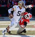 Georgia Tech quarterback Justin Thomas (5) escapes from Georgia's Leonard Floyd (84) in the end zone during the second half of an NCAA college football game Saturday, Nov. 29, 2014, in Athens, Ga. Georgia Tech won 30-24 in overtime. (AP Photo/David Tulis)