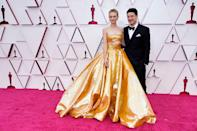 <p>The Promising Young Woman actor attended in a beautiful sequinned gold bandeau dress by Valentino Couture with her Mumford and Sons husband Marcus Mumford.</p>