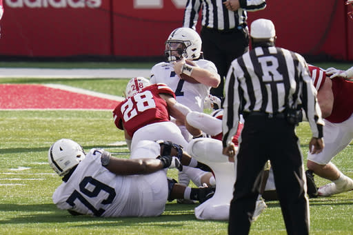 Nebraska linebacker Luke Reimer (28) brings down Penn State quarterback Will Levis (7) during a fourth down attempt to reach the Nebraska end zone, in the second half of an NCAA college football game in Lincoln, Neb., Saturday, Nov. 14, 2020. Nebraska won 30-23. (AP Photo/Nati Harnik)
