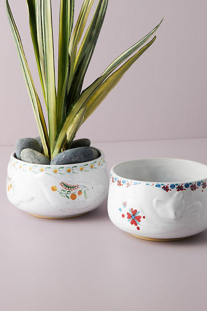"""<h2>Alvida Pot</h2><br>Although this planter has a lovely floral design, it's not the best home for flowers. Instead, place your favorite succulents or any other small sprouts inside this pot for some refreshing decor. <br><br><em>Shop</em> <strong><em><a href=""""http://anthropologie.com"""" rel=""""nofollow noopener"""" target=""""_blank"""" data-ylk=""""slk:Anthropologie"""" class=""""link rapid-noclick-resp"""">Anthropologie</a></em></strong><br><br><br><br><strong>Anthropologie</strong> Alvida Pot, $, available at <a href=""""https://go.skimresources.com/?id=30283X879131&url=https%3A%2F%2Ffave.co%2F3hC1EW8"""" rel=""""nofollow noopener"""" target=""""_blank"""" data-ylk=""""slk:Anthropologie"""" class=""""link rapid-noclick-resp"""">Anthropologie</a>"""