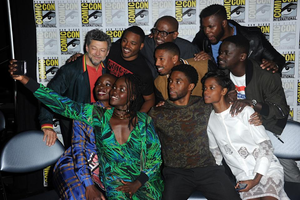 SAN DIEGO, CA - JULY 22:  (Back row L-R) Actor Andy Serkis, director Ryan Coogler, actors Forest Whitaker, Michael B. Jordan, Winston Duke, and Daniel Kaluuya, (Front row L-R) actors Danai Gurira, Lupita Nyong'o, Chadwick Boseman, and Letitia Wright pose for a selfie at Comic-Con International 2017 Marvel Studios 'Black Panther' Presentation at San Diego Convention Center on July 22, 2017 in San Diego, California.  (Photo by Albert L. Ortega/Getty Images)