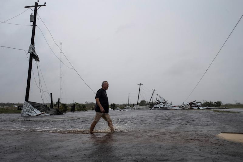 A man walks through floods waters after surveying his property, which was hit by Hurricane Harvey in Rockport, Texas. (Adrees Latif / Reuters)