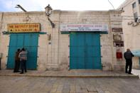 Tourist shops in Bethlehem near the Church of the Nativity have closed their doors amid the coronavirus pandemic
