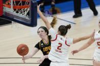Iowa's McKenna Warnock (14) makes a pass against Maryland's Mimi Collins (2) during the second half of an NCAA college basketball game in the championship of the Big Ten Conference tournament, Saturday, March 13, 2021, in Indianapolis. (AP Photo/Darron Cummings)