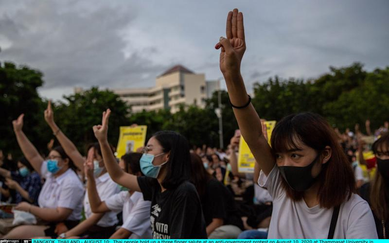 Protesters in Bangkok hold up a three-finger salute at an anti-government protest - Lauren DeCicca/Getty Images AsiaPac