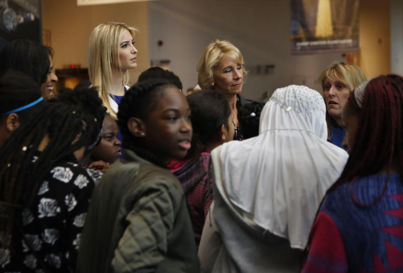 Ivanka Trump, left, and Education Secretary Betsy DeVos, center, listen as NASA Astronaut Kay Hire speaks during their visit to the Smithsonian's National Air and Space Museum in Washington, Tuesday, March 28, 2017, to celebrate Women's History Month. (AP Photo/Manuel Balce Ceneta)