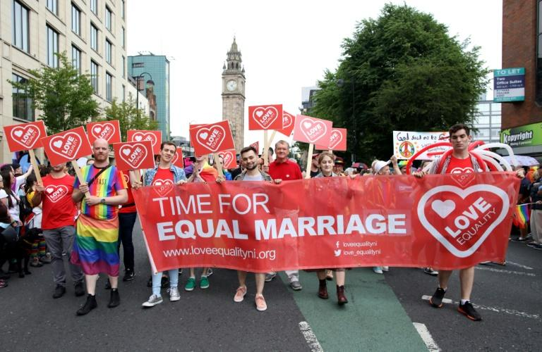 Same-sex marriage and abortion laws in Northern Ireland were liberalised in a landmark shift for the province aimed at bringing it into line with mainland Britain (AFP Photo/Paul Faith)