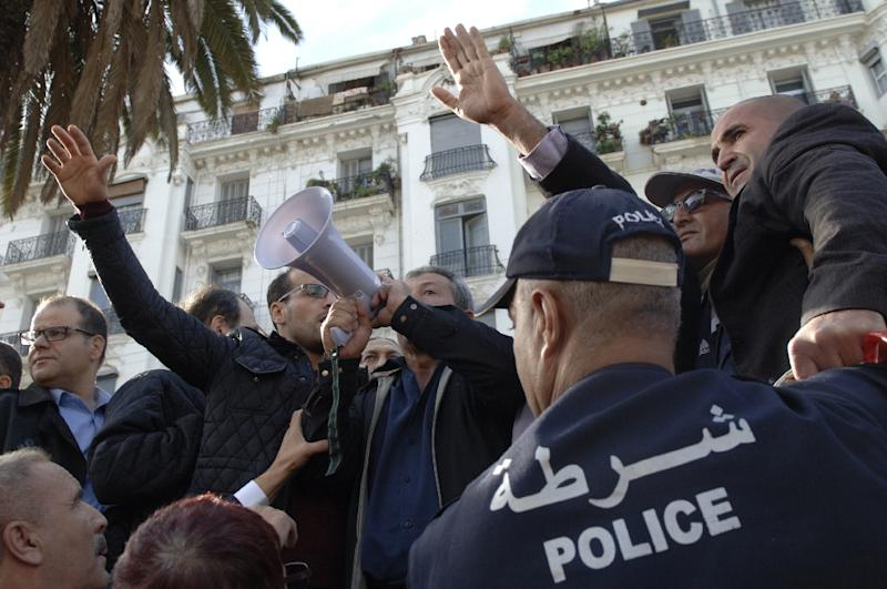 Algerian trade unionists gather outside the People's National Assembly bulding in the capital Algiers on November 27, 2016, to protest a draft law on pension reforms