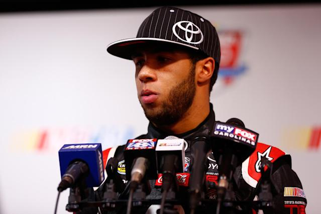 DAYTONA BEACH, FL - FEBRUARY 13: NASCAR Camping World Truck Series driver Darrell Wallace Jr. speaks to the media during the 2014 NASCAR Media Day at Daytona International Speedway on February 13, 2014 in Daytona Beach, Florida. (Photo by Brian Lawdermilk/Getty Images)