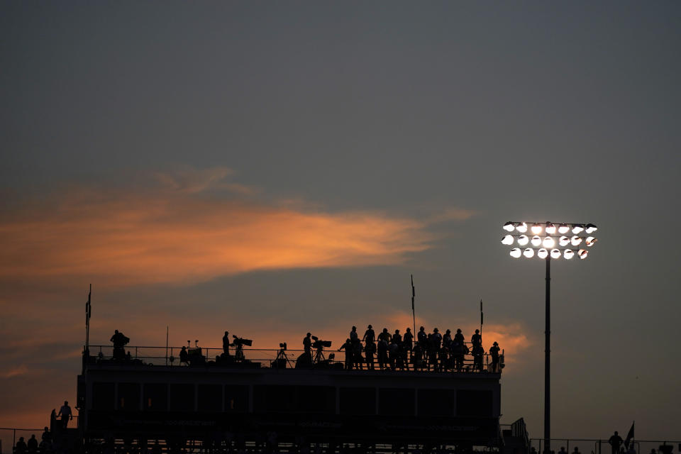 People watch during an IndyCar auto race at World Wide Technology Raceway on Saturday, Aug. 21, 2021, in Madison, Ill. (AP Photo/Jeff Roberson)
