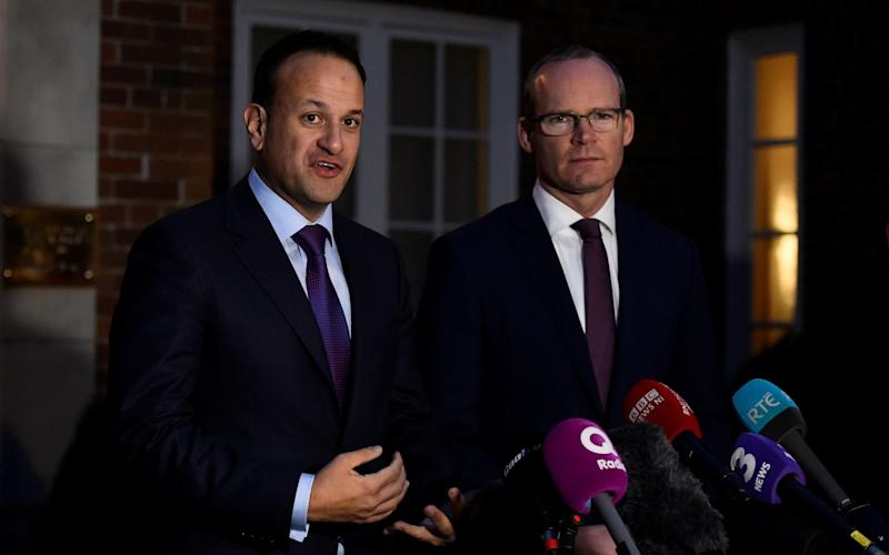 Ireland's Deputy Prime Minister Simon Coveney, right, warned those pursuing Brexit they could be undermining the foundations of a fragile peace process in Northern Ireland - REUTERS