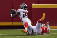 Atlanta Falcons safety Keanu Neal intercepts a pass intended for Kansas City Chiefs quarterback Patrick Mahomes during the first half an NFL football game, Sunday, Dec. 27, 2020, in Kansas City. (AP Photo/Charlie Riedel)