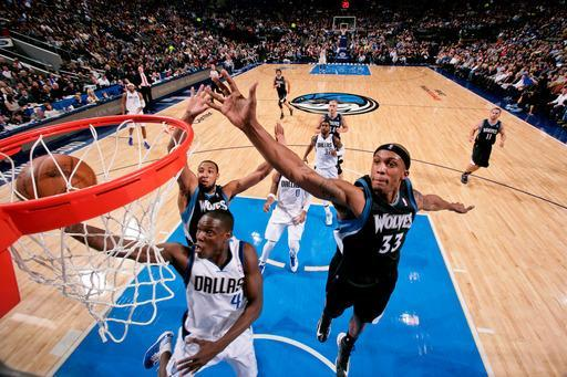 DALLAS, TX - JANUARY 14: Darren Collison #4 of the Dallas Mavericks drives to the basket against Dante Cunningham #33 and Derrick Williams #7 of the Minnesota Timberwolves on January 14, 2013 at the American Airlines Center in Dallas, Texas. (Photo by Glenn James/NBAE via Getty Images)