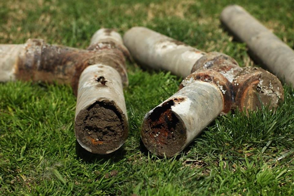 Old Corroded and Blocked Steel Household Pipes