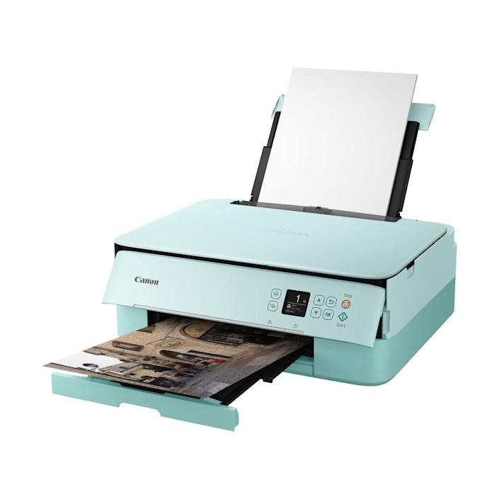 """<strong>Pages Per Minute: </strong>In black and white, this printer can print 13 pages per minute. <br><strong>Monochrome Vs. Color:</strong> It can do both!<br><strong>Cartridge Details: </strong>This printer includes a Canon PG-240 Black ink tank and CLI-241 color ink tank. <br> <strong>What Else Can This Printer Do: </strong>You can copy and scan with this printer. It also has a built-in status bar so you know what it's up to. <br><strong> $$$:</strong> <a href=""""https://fave.co/3ke0S2b"""" rel=""""nofollow noopener"""" target=""""_blank"""" data-ylk=""""slk:Find it for $65 at Adorama"""" class=""""link rapid-noclick-resp"""">Find it for $65 at Adorama</a>. Keep in mind that it's on backorder."""