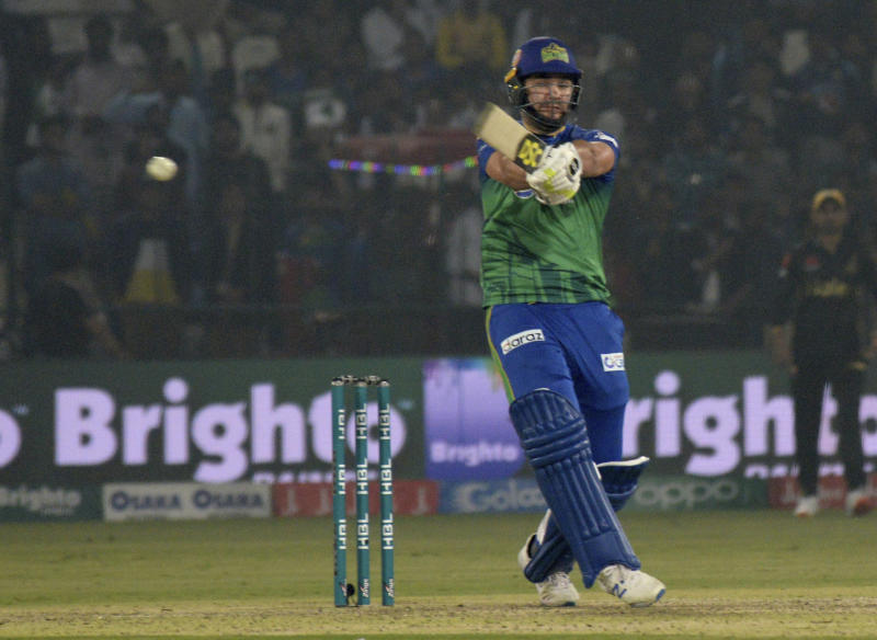 Rilee Rossouw of Multan Sultans plays a pull shot as he scores unbeaten 49 against Peshawar Zalmi in the Pakistan Super League match in Multan, Pakistan, Wednesday, Feb 26, 2020. Multan Sultan beat Peshawar Zalmi by six wickets. (AP Photo/Asim Tanveer)