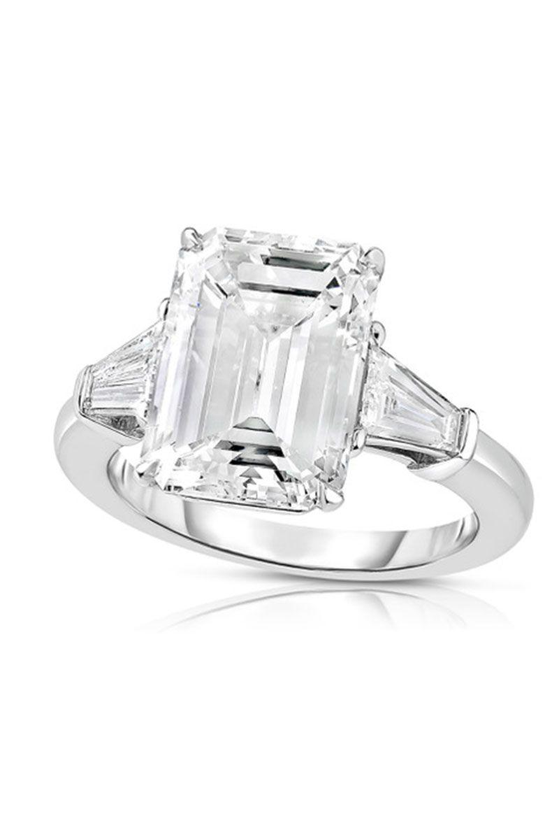 "<p><em><strong>Douglas Elliott for Marisa Perry Atelier</strong> Emerald Cut Diamond Engagement Ring With Tapered Baguettes, price upon request, <a href=""https://www.marisaperry.com/5-05-carat-emerald-cut-diamond-engagement-ring-with-tapered-baguettes-marisa-perry-by-douglas-elliott/"" rel=""nofollow noopener"" target=""_blank"" data-ylk=""slk:marisaperry.com"" class=""link rapid-noclick-resp"">marisaperry.com</a>.</em></p><p><a class=""link rapid-noclick-resp"" href=""https://www.marisaperry.com/5-05-carat-emerald-cut-diamond-engagement-ring-with-tapered-baguettes-marisa-perry-by-douglas-elliott/"" rel=""nofollow noopener"" target=""_blank"" data-ylk=""slk:SHOP"">SHOP</a></p>"