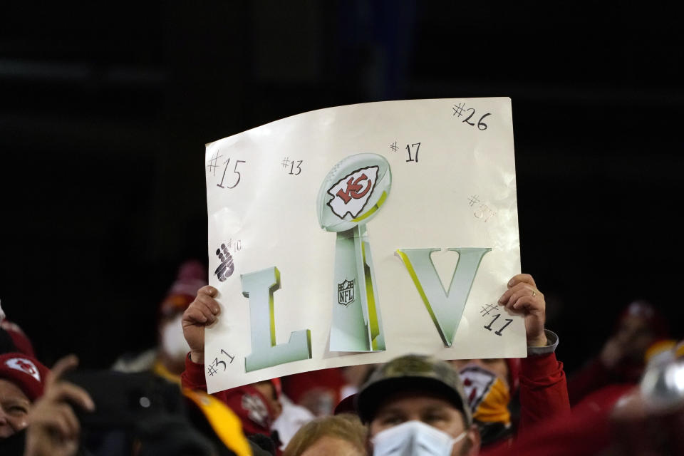 A fan holds up a sign during the second half of the AFC championship NFL football game between the Kansas City Chiefs and the Buffalo Bills, Sunday, Jan. 24, 2021, in Kansas City, Mo. (AP Photo/Charlie Riedel)