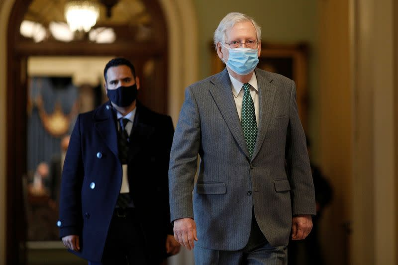 Senate Majority Leader McConnell walks to his office from the Senate Chamber on Capitol Hill in Washington