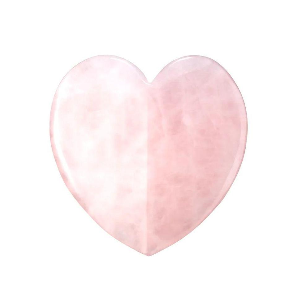 """<p><strong>KORA Organics</strong></p><p>sephora.com</p><p><strong>$58.00</strong></p><p><a href=""""https://go.redirectingat.com?id=74968X1596630&url=https%3A%2F%2Fwww.sephora.com%2Fproduct%2Frose-quartz-heart-facial-gua-sha-P432835&sref=https%3A%2F%2Fwww.bestproducts.com%2Fbeauty%2Fg36064681%2Fbest-face-massagers%2F"""" rel=""""nofollow noopener"""" target=""""_blank"""" data-ylk=""""slk:Shop Now"""" class=""""link rapid-noclick-resp"""">Shop Now</a></p><p><a href=""""https://www.bestproducts.com/beauty/a28688066/gua-sha-tools/"""" rel=""""nofollow noopener"""" target=""""_blank"""" data-ylk=""""slk:Gua sha is an ancient Eastern practice"""" class=""""link rapid-noclick-resp"""">Gua sha is an ancient Eastern practice</a> — """"gua"""" means scrape, and """"sha"""" means sand in Chinese — with multiple benefits, such as promoting blood flow, lifting and contouring the face, and relieving facial tension, all while promoting brighter, tighter skin. Sculpting out your face never seemed so easy.</p>"""