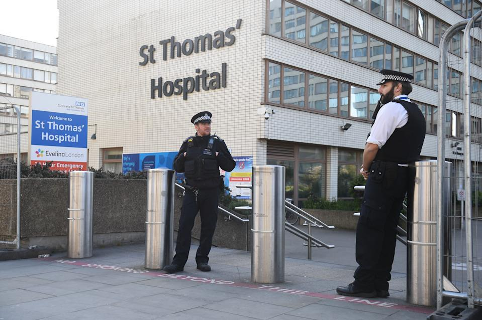 Police officers outside St Thomas' Hospital in Central London where Prime Minister Boris Johnson is in intensive care as his coronavirus symptoms persist.