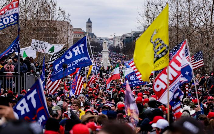 Pro-Trump supporters gather outside the U.S. Capitol before it was stormed  - Getty