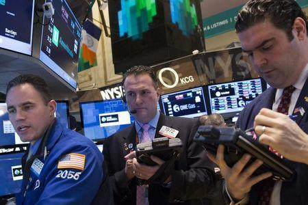 Traders work on the floor of the New York Stock Exchange (NYSE)