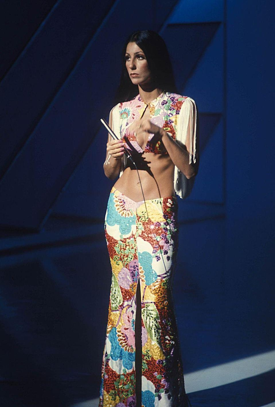 <p>Get your hippie-chic on à la Cher, in floral flares and a coordinating crop top. </p>