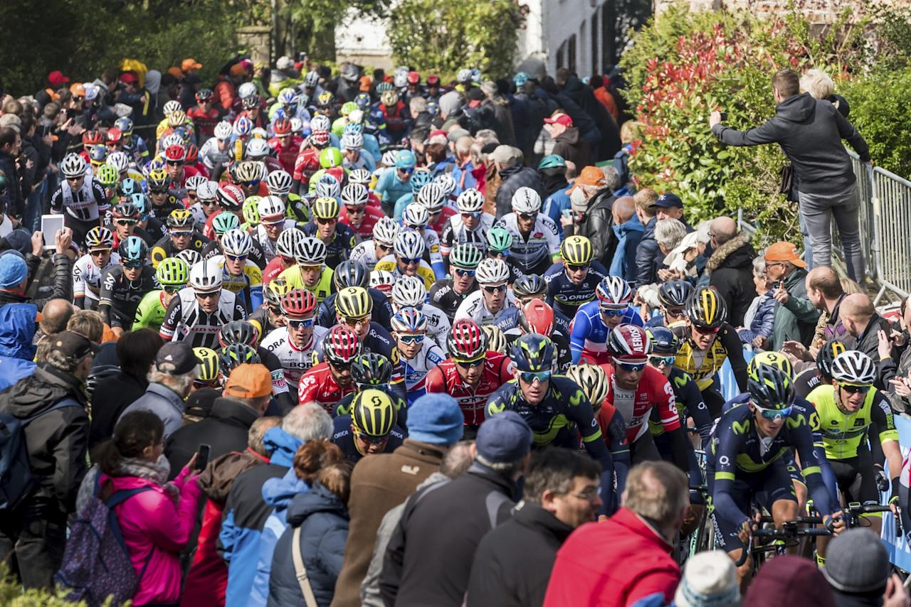 <p>The pack of riders climbs on the Wall of Huy during the Walloon Arrow cycling race, in Huy, Belgium. (AP Photo/Geert Vanden Wijngaert) </p>