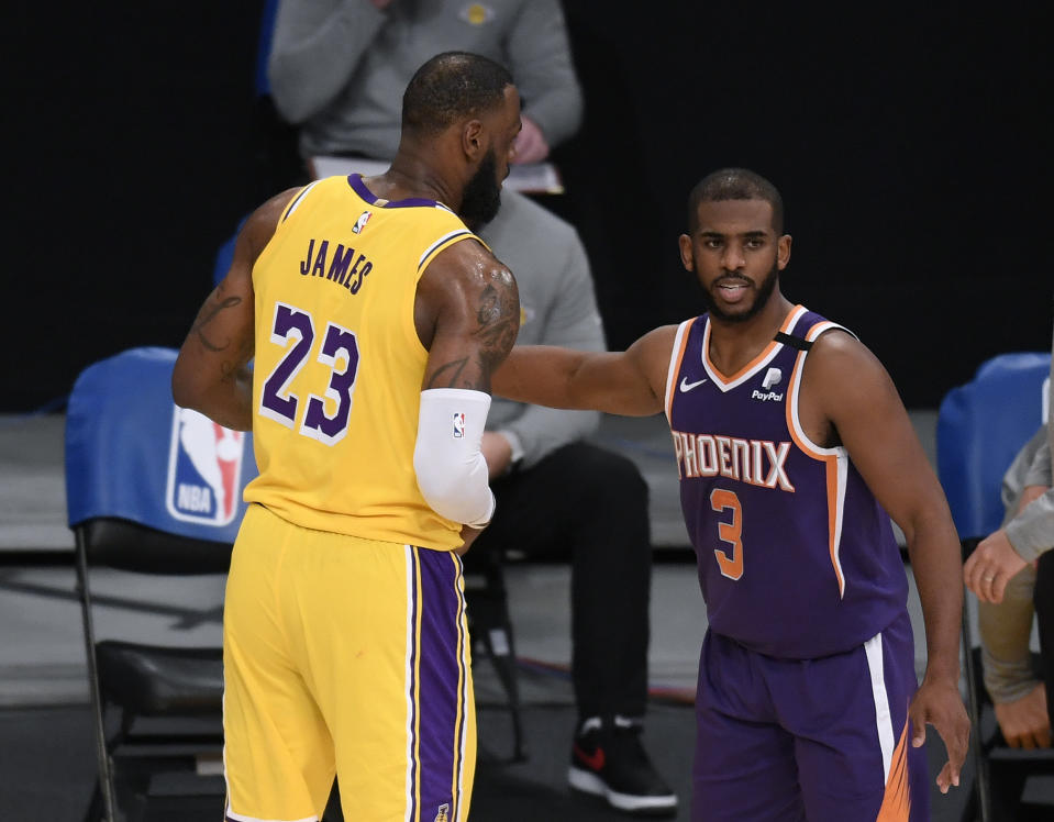 LeBron James and Chris Paul will meet in the playoffs for the first time. (Harry How/Getty Images)