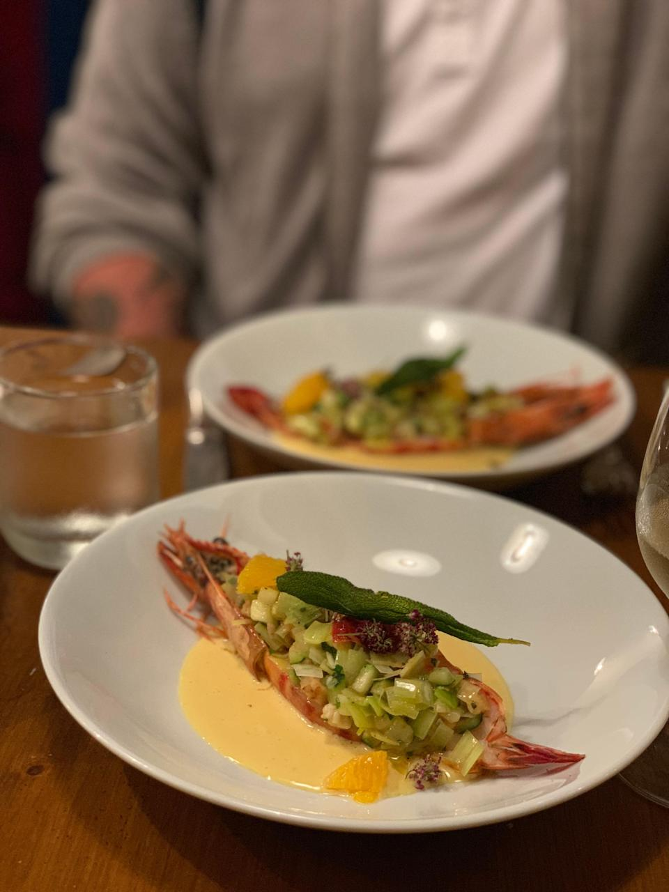 """<p><strong>What were your first impressions when you arrived?</strong> Arriving at this this blink-and-you-miss-it restaurant on a side street in the 10th arrondissement, you will likely ask: """"Wait, is this it?"""" But yes, it is. This super-small, quite narrow spot with an open kitchen, stone walls and mismatched wooden chairs is precisely the place you booked ages ago, and that you will be talking about for ages after. Single-bulb fixtures hang from the ceiling, and an industrial-looking shelving unit doubles as a bussing station and bar-cum-kitchen counter as storage for condiments. It's rustic, simple, and delightfully cool; like you're somewhere you <em>want</em> to be as opposed to somewhere you think you """"should"""" be.</p> <p><strong>What's the crowd like?</strong> This is a crowd of people who know a thing or two about food preparation, have adventurous palettes, and follow (or are friends with) chef Katsuaki Okiyama. On the night we went, we heard various languages spoken—from Japanese to French, English, and Dutch—and there were intimate couples, siblings, and groups of friends eager to tuck into the night's mystery menu.</p> <p><strong>What should we be drinking?</strong> This is, first and foremost, a restaurant. While the beverage menu has been carefully considered to pair nicely with rotating menu items—with a strong focus on natural wines, as well as a handful of sake options—you wouldn't come here just to drink. There was not even a specific drink list; rather, your server will offer suggestions based on that evening's menu and your thirst level.</p> <p><strong>Main event: the food. Give us the lowdown—especially what not to miss.</strong> This is a tasting-menu-only restaurant. No a la carte options; and, in fact, their website clearly states that it may not work for those with certain allergies, intolerances or other dietary restrictions. Chef Katsuaki Okiyama makes what he plans, and you either are going to eat it (and, I promise you, love it) or you w"""