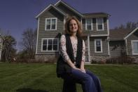 Jana Elkadri poses for a picture outside her Brookfield, Wis., home on April 23, 2021. (AP Photo/Morry Gash)