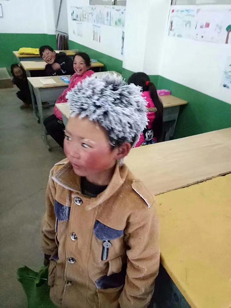 The boy, 10, walked three miles to school in freezing temperatures (Picture: Asia Wire)