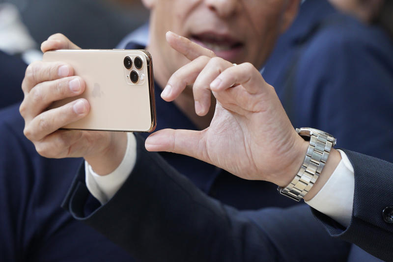Apple team members demo the new cameras on iPhone 11 Pro for guests during an event to announce new products Tuesday, Sept. 10, 2019, in Cupertino, Calif. (AP Photo/Tony Avelar)