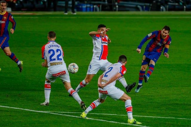Messi curled home a brilliant second goal on his club record-equalling appearance